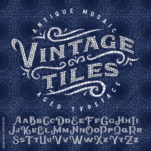 Fototapeta Vintage antique mosaic typeface made of hundreds of aged tiles
