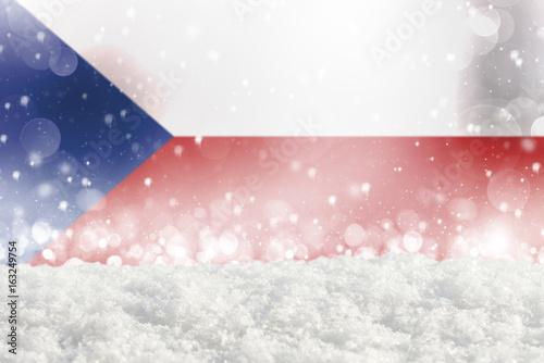 Fotografie, Obraz Defocused Czech Republic flag as a winter Christmas background with falling snow