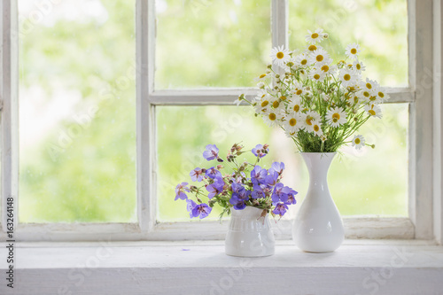 Flowers In Vases On Windowsill Buy This Stock Photo And Explore