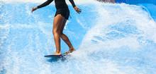 Girl On Black Swimsuit Surfing...