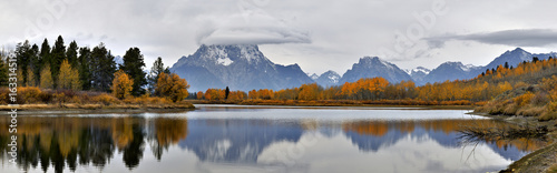 Panoramic image of Mt Moran on a fall morning relected on the Sanke river's Oxbow Bend