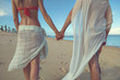 Couple in love holding hands on the tropical beach.