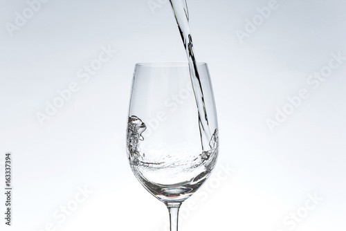 Water Pouring Into Wine Glass Buy This Stock Photo And