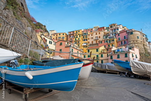 Foto op Aluminium Rome Magical landscape with boats on the streets of Manarola in Cinque Terre, Liguria, Italy, Europe