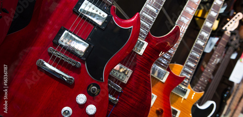 Canvas Prints Music store Many electric guitars hanging on wall in the shop