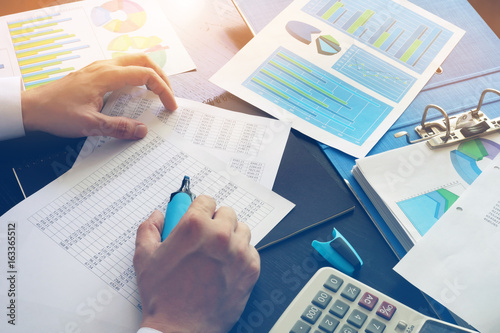 Accountant checking financial data. Accounting concept. Wallpaper Mural