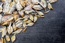 Dry Fish With Sunny On Black Wooden Floor, Small Dried Fish And Pattern Of Dried Fish, Top View Of Dry Fish On Table
