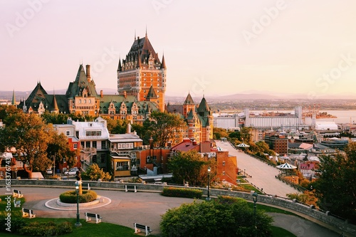 Poster Canada Frontenac Castle in Old Quebec City in the beautiful sunrise light. Travel, vacation, history, cityscape, nature, summer, hotels and architecture concept