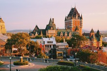 Frontenac Castle In Old Quebec City In The Beautiful Sunrise Light. Travel, Vacation, History, Cityscape, Nature, Summer, Hotels And Architecture Concept