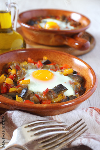 Ratatouille with egg in two ceramic plates