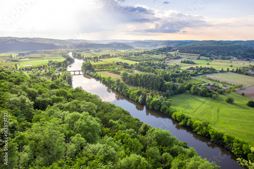 Papiers peints Lieu d Europe Aerial landscape view on Dordogne river with the old bridge and beautiful fields near Domme village in France