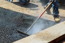 Workers On Asphalting Paver Du...