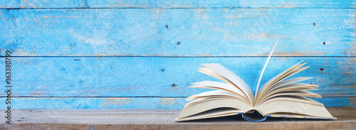 open book on blue grungy background, good copy space Wallpaper Mural