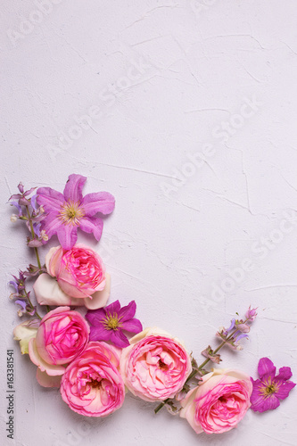 Pink roses and violet summer clematis flowers on grey textured pink roses and violet summer clematis flowers on grey textured background mightylinksfo