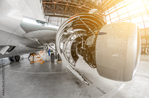 Fotografie, Obraz  Aircraft service, view of the open engine hood