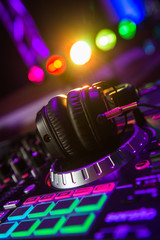 Fototapeta na wymiar Dj mixer with headphones at a nightclub