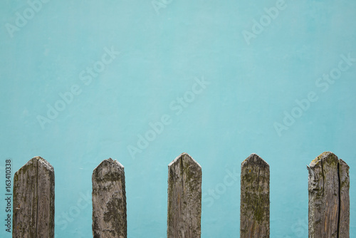 Fotografie, Obraz  Old wooden fence, the wall whitewashed by lime in sea wave color on background ,