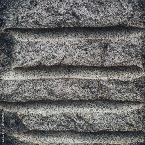 Fotografia  Granite monument, texture. Suitable for labels and design