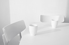 Two Empty Chairs With Two Mugs