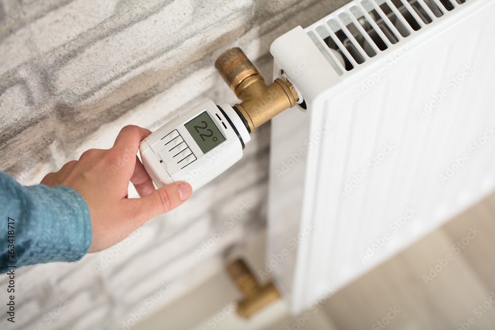 Fototapety, obrazy: Person Adjusting Temperature On Thermostat