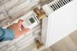 Leinwanddruck Bild - Person Adjusting Temperature On Thermostat