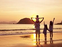 Asian Family Watching Sunrise ...