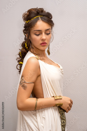 portrait of a beautiful graceful greek young woman in a traditional antique whit Canvas Print