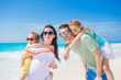 Portrait of happy family on a tropical beach
