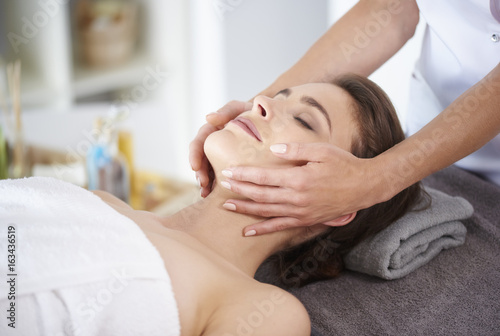 Poster Spa Massage of face at the spa salon