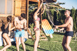 Guy pouring champagne over his friends