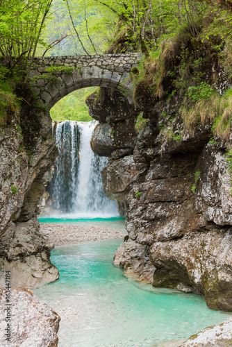Foto op Aluminium Bos rivier Waterfalls. Crystalline water. Mountain creek. Chiusaforte, Friuli