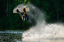 Man Wakeboarding And Jumping