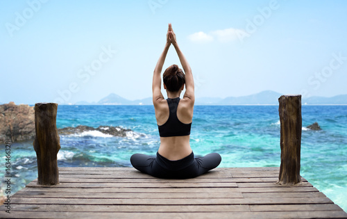 Fotografie, Obraz Healthy woman lifestyle exercising vital meditate and  practicing yoga at seashore, nature background