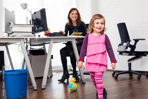 Fotografie, Obraz  Working Mom And Daughter At The Office