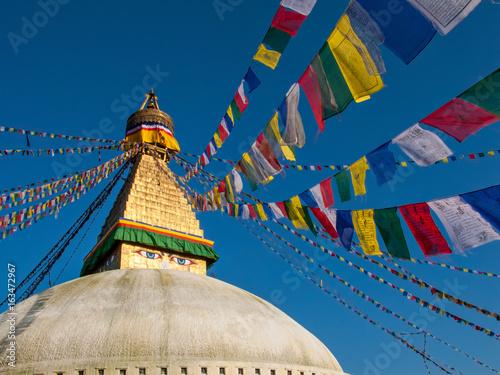 Staande foto Nepal Kathmandu, Nepal: Boudhanath, a huge Buddhist stupa with blue eyes and a sacred prayer flags.