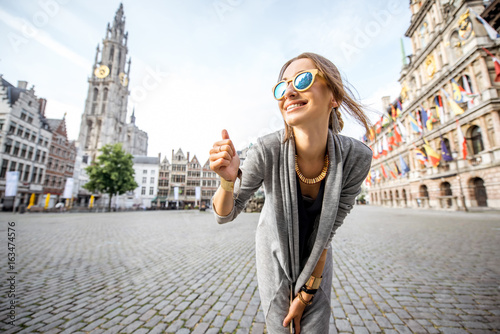 Keuken foto achterwand Antwerpen Young and happy woman tourist showing ok standing on the Great Market square during the morning in Antwerpen, Belgium