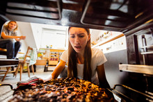Young Woman With Burnt Pizza