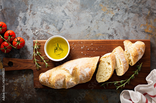Photo Homemade baguette with olive oil and salt