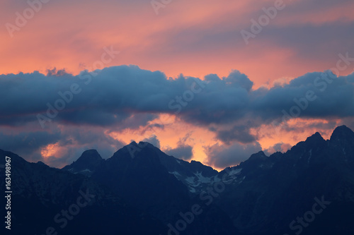 Fototapeta The tops of the mountains at sunset obraz na płótnie
