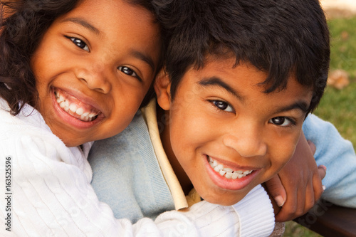 Brother and sister smiling and laughing. Poster Mural XXL