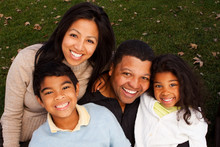 Biracial Family Laughing And S...