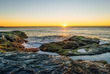 Sunrise Over Rocks And Waves Australia