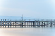 Old bridge over the mystical blue sea water, The Black Sea shore coastline seaside