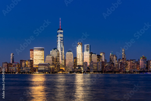 Fototapety, obrazy: New York City Financial District skyscrapers and Hudson River at dusk. Panoramic view of Lower Manhattan