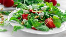 Fresh Strawberry Salad With Feta Cheese, Arugula On White Plate