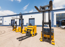 London, England, 10/05/ 2016 Big Vivid Yellow Modern Pedestrian Forklift Machines. Pedestrian Counterbalanced Stackers And Heavy Duty Industrial Powered Pedestrian Stackers.