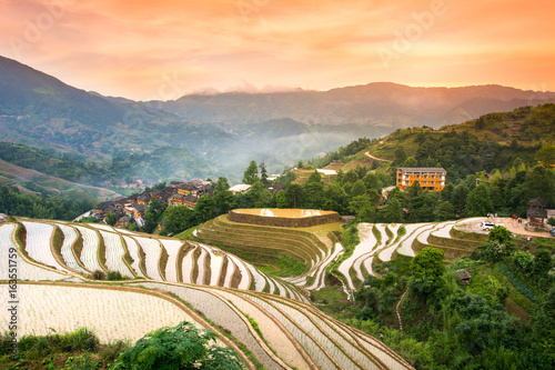Staande foto Rijstvelden Sunset over terraced rice field in Longji, Guilin in China