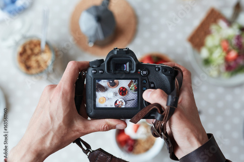 Obraz Professional food-photographer making shot of food for advert - fototapety do salonu