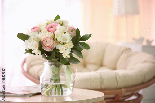 Beautiful bouquet with white freesia on table at home