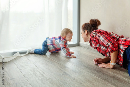 Fototapeta Young mother playing with her child obraz na płótnie